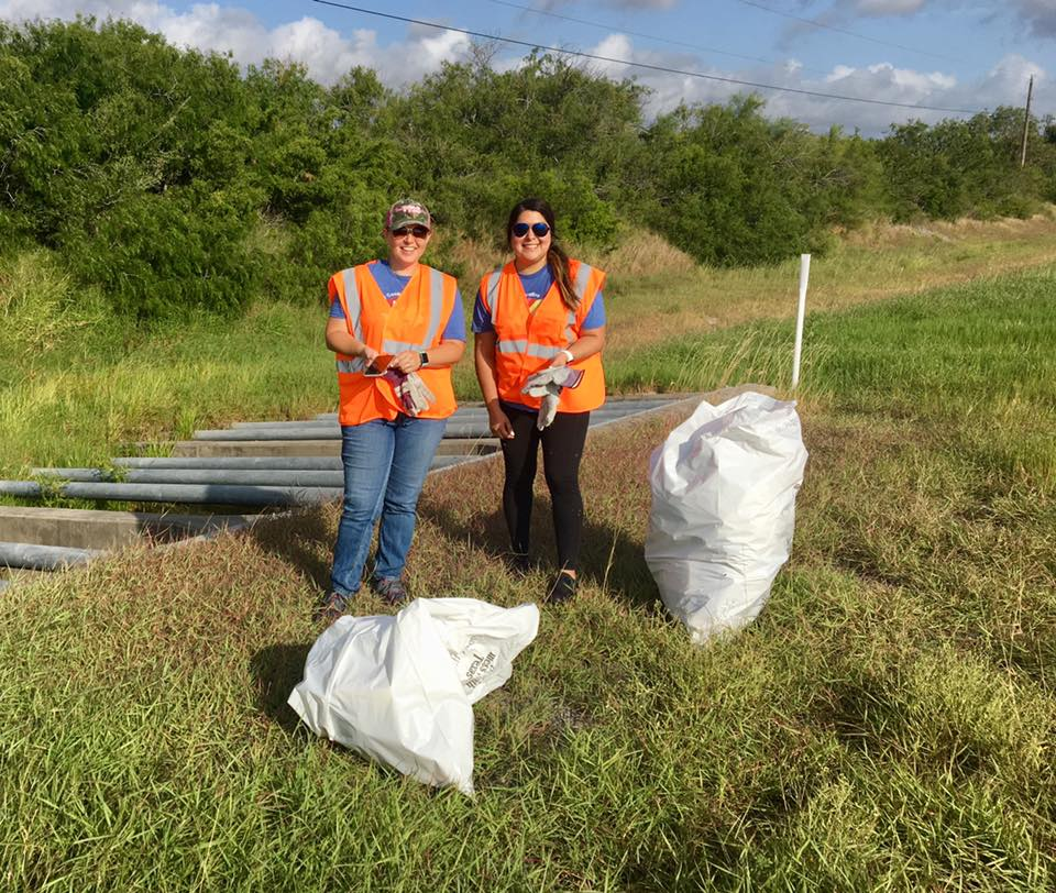 Employees picking up trash at Adopt-A-Highway